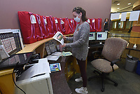 Letitia Maurice with the library staff arranges materials for display on Tuesday April 20 2021 at the Bentonville Public Library.<br />(NWA Democrat-Gazette/Flip Putthoff)
