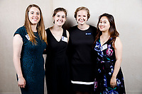 USA International Harp Competition organizers Abigail Brower, left, Carrie Anderson, Melanie Mashner and Cindy Songwon Lee pose at a photo booth during the opening reception and dinner of the 11th USA International Harp Competition at Indiana University in Bloomington, Indiana on Wednesday, July 3, 2019. (Photo by James Brosher)