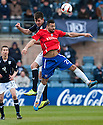 Dundee's Declan Gallagher gets above Cowdenbeath's Kane Hemmings.