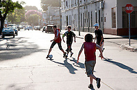 Children play soccer on the street in Montevideo, Uruguay. Matilde Campodonico/Archivo Latino