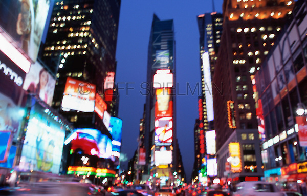 Defocused View of Times Square at Dusk, Midtown Manhattan, New York City, New York State, USA..<br /> <br /> PHOTO AVAILABLE FOR COMMERCIAL AND EDITORIAL LICENSING FROM GETTY IMAGES.  Please go to www.gettyimages.com and search for image # a0142-000148.<br /> <br /> Original Image Photographed on Color Transparency Film.