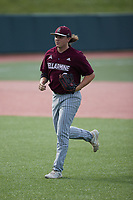 Bellarmine Knights left fielder Matt Higgins (6) jogs off the field between innings of the game against the Liberty Flames at Liberty Baseball Stadium on March 9, 2021 in Lynchburg, VA. (Brian Westerholt/Four Seam Images)