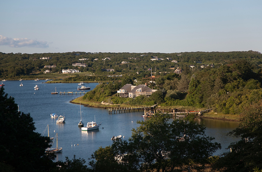 Boats and summer homes on Menemsha Pond in Chilmark, MA on the island of Martha's Vineyard.