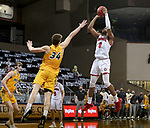 SIOUX FALLS, SD - MARCH 8: Stanley Umude #0 of the South Dakota Coyotes shoots over Rocky Kreuser #34 of the North Dakota State Bison during the Summit League Basketball Tournament at the Sanford Pentagon in Sioux Falls, SD. (Photo by Dave Eggen/Inertia)