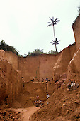 Ouro Verde, Brazil. Overview; garimpeiros (prospectors) with hand tools digging in an illegal gold mine - garimpo.