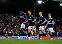 21st September 2021; Craven Cottage, Fulham, London, England; EFL Cup Football Fulham versus Leeds; Jamie Shackleton, Adam Forshaw and Junior Firpo of Leeds United celebrate as they run towards Goalkeeper Illan Meslier of Leeds United after he saved a penalty from Rodrigo Muniz of Fulham to win the penalty shoot out
