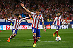 Atletico de Madrid's Arda Turan and Griezmann react during quarterfinal first leg Champions League soccer match at Vicente Calderon stadium in Madrid, Spain. April 14, 2015. (ALTERPHOTOS/Victor Blanco)