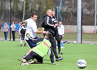 Thursday 11 April 2013<br /> Pictured: First team coach Alan Curtis (R) shoots wide, against Riath Al-Samarrai (L) of the reporters team.<br /> Re: Friendly game, Swansea City FC coaching staff v sports reporters at the Swansea City FC training ground. Final score 10-4.