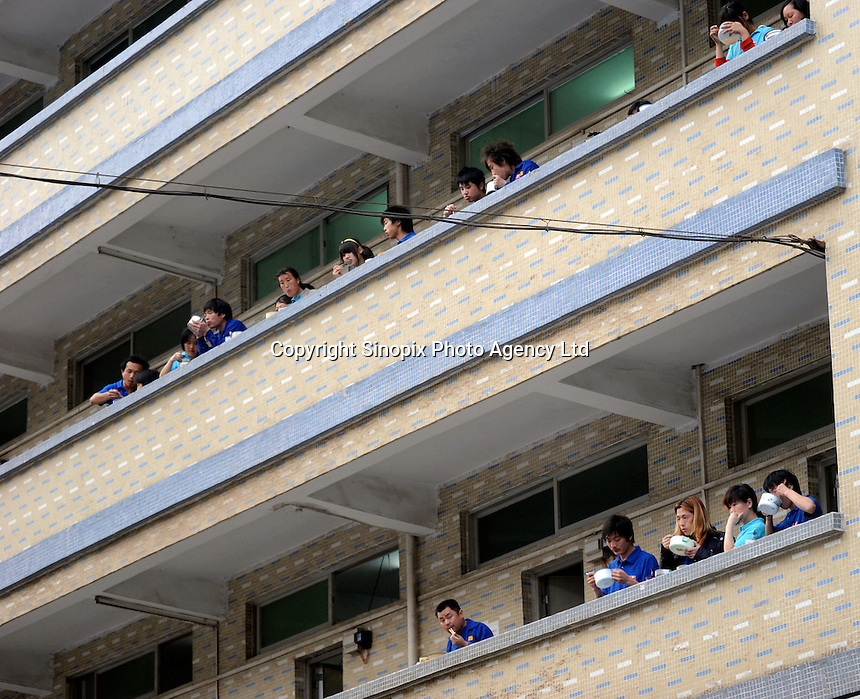 Migrant workers eat from bowls at their dormitories in Shenzhen, China. Based on official statistics, migrant workers in the Pearl River Delta region, comprising nine cities - Guangzhou, Shenzhen Zhuhai,Foshan, Jiangmen, Zhongshan, Dongguan, Huizhou, Zhaoqing - have fallen in number in 2009 by 22.5% to 32.82m. The labor shortages are forcing managements to boost wages and other incentives to attract and retain staff..