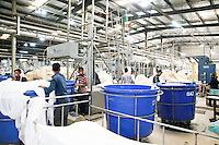 Bangladeshi garments workers working in the dyeing section of a garments. Gazipur, near Dhaka, Bnagladesh