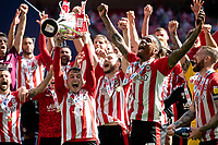 Sergi Canós of Brentford celebrates with the trophy at full time of the Sky Bet Championship Play Off Final match between Brentford and Swansea City at Wembley Stadium in London, England, UK. Saturday 29 May 2021