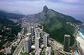 Rio de Janeiro, Brazil. Wealthy Sao Conrado beach resort with favela Rocinha behind, showing rich-poor contrast.