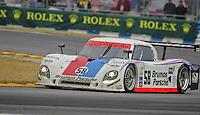The #58 Brumos Porsche of David Donohue, Darren Law, Buddy Rice and Antonio Garcia races to victory in the Rolex 24 at Daytona , Daytona International Speedway, Daytona Beach, FL, January 2009.  )Photo by Brian Cleary)