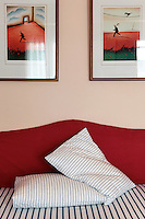 bed with red headboard