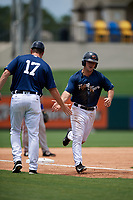 Lakeland Flying Tigers left fielder Dustin Frailey (7) is congratulated by Lakeland Flying Tigers manager Andrew Graham (17) as he rounds third base after hitting a home run in the bottom of the third inning during a game against the St. Lucie Mets on June 11, 2017 at Joker Marchant Stadium in Lakeland, Florida.  Lakeland defeated St. Lucie 1-0.  (Mike Janes/Four Seam Images)