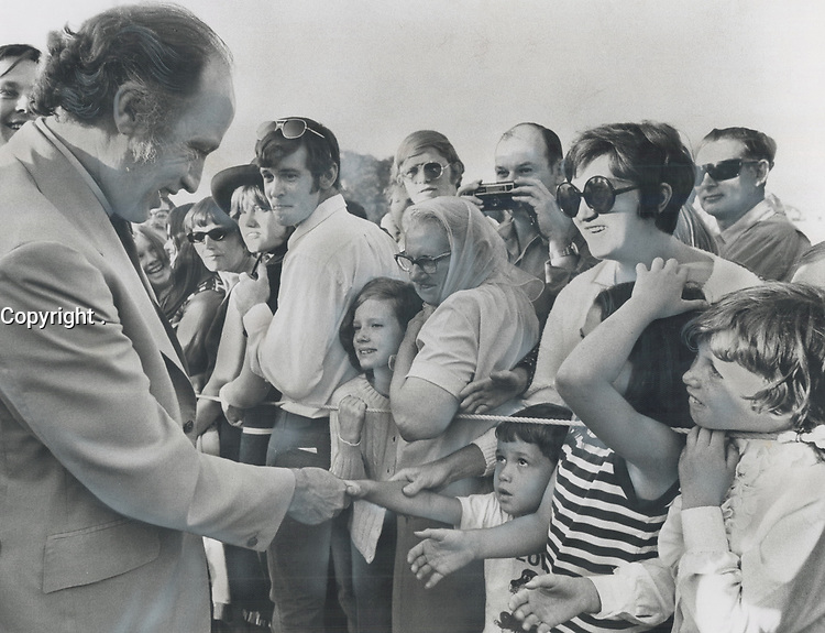 1971 FILE PHOTO - ARCHIVES -<br /> <br /> 1971 - FILE -<br /> <br /> The youngsters reach out, some with warm smiles, and one with wide-eyed wonder, to shake the hand of Prime Minister Pierre Trudeau yesterday as he was met by a crowd of about 2,000 on his arrival by helicopter to visit the community centre in Aurora.<br /> <br /> PHOTO : <br /> Bull, Ron<br /> <br /> PHOTO : Ron BULL - Toronto Star Archives - AQP