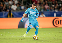 CARSON, CA - SEPTEMBER 21: David Bingham #1 of the Los Angeles Galaxy crosses a ball during a game between Montreal Impact and Los Angeles Galaxy at Dignity Health Sports Park on September 21, 2019 in Carson, California.