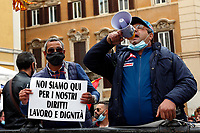 Demonstration of the workers and holders of VAT number of fairs and patronal festivals. The workers,  that have been out of work for 8 months, gathered this morning in Montecitorio square equipped with signs, to ask the Government for unemployment benefits and threatening to waive their licenses.<br /> Rome (Italy), October 26th 2020<br /> Photo Samantha Zucchi Insidefoto