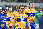 Patrick O Connor of Clare and his team mates walk behind the band before their Munster championship game against Limerick in Ennis. Photograph by John Kelly.