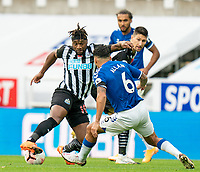 1st November 2020; St James Park, Newcastle, Tyne and Wear, England; English Premier League Football, Newcastle United versus Everton; Allan Saint-Maximin of Newcastle United on the ball cuts inside as Allan of Everton makes a tackle