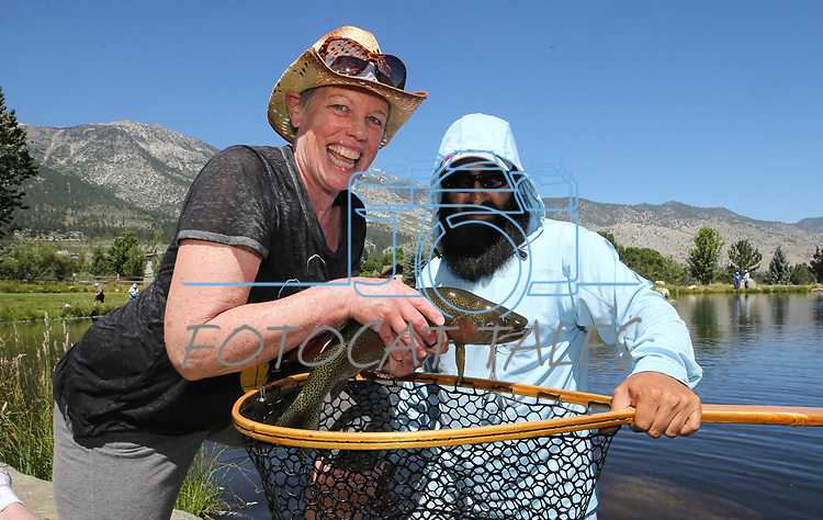 Breast cancer survivor Karen Kernan, of Reno, and her guide Jose Luna pose with her catch during a Casting for Recovery retreat in Gardnerville, Nev., on Friday, June 30, 2017. The nationwide program, hosted locally with Carson Tahoe Cancer Center, pairs cancer survivors with fly-fishing guides.   <br /> Photo by Cathleen Allison/Nevada Photo Source