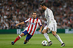 Real Madrid's Cristiano Ronaldo (R) and Atletico del Madrid´s Koke during quarterfinal second leg Champions League soccer match at Santiago Bernabeu stadium in Madrid, Spain. April 22, 2015. (ALTERPHOTOS/Victor Blanco)