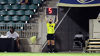 CARY, NC - AUGUST 01: Fourth Official Emma Richards holds up the signboard indicating five minutes of second half stoppage time during a game between Birmingham Legion FC and North Carolina FC at Sahlen's Stadium at WakeMed Soccer Park on August 01, 2020 in Cary, North Carolina.