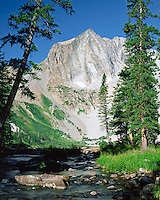 Tree-framed Hagerman Peak looms above the outlet from Snowmass Lake in the Maroon Bells-Snowmass Wilderness.