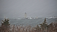 Falling snow obscures the view to Dutch Island Lighthouse.