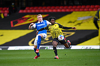 20th March 2021; Vicarage Road, Watford, Hertfordshire, England; English Football League Championship Football, Watford versus Birmingham City; Carlos Sanchez competes for the ball with Kristian Pedersen of Birmingham.