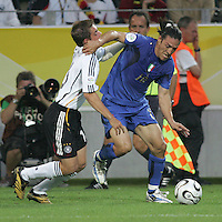 Mauro Camoranesi, Philipp Lahm.  Italy defeated Germany, 2-0, in overtime in their FIFA World Cup semifinal match at FIFA World Cup Stadium in Dortmund, Germany, July 4, 2006.