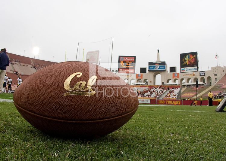 CAL football is pictured sitting on the ground before the game between CAL and USC at LA Memorial Coliseum in Los Angeles, California.  USC defeated California, 48-14.