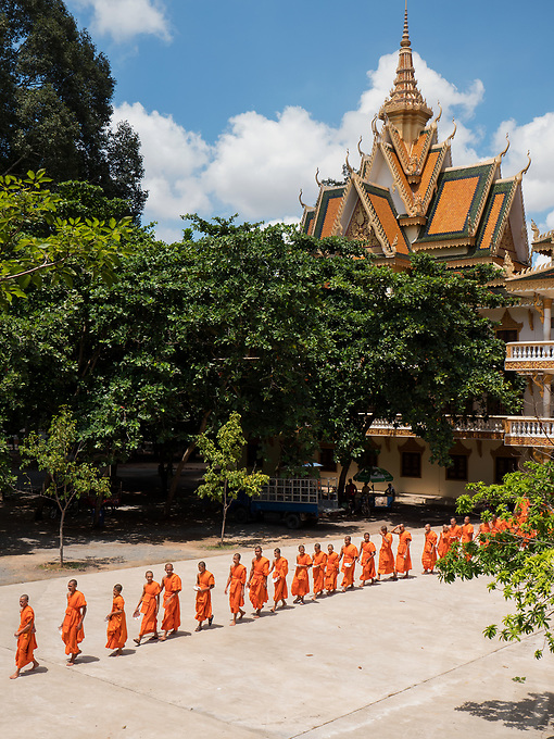 Hundreds of Buddhist Monks assemble before taken their daily meal at 11AM at a Monastery on the outskirts of Phnom Penh, Cambodia. Chin Puskak, Temple,