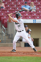Cedar Rapids Kernels third baseman Travis Harrison #17 bats during a game against the Lansing Lugnuts at Veterans Memorial Stadium on April 29, 2013 in Cedar Rapids, Iowa. (Brace Hemmelgarn/Four Seam Images)