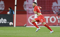 TORONTO, ON - OCTOBER 15: Jonathan Osorio #21 celebrates a Canada goal during a game between Canada and USMNT at BMO Field on October 15, 2019 in Toronto, Canada.