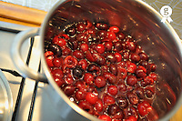 Cherries in pan, cooking for jam (Licence this image exclusively with Getty: http://www.gettyimages.com/detail/82406650 )