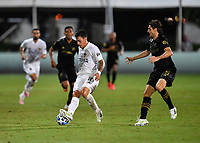 LAKE BUENA VISTA, FL - JULY 18: Cristian Pavón #10 of LA Galaxy turns away from Dejan Jakovic #5 of LAFC during a game between Los Angeles Galaxy and Los Angeles FC at ESPN Wide World of Sports on July 18, 2020 in Lake Buena Vista, Florida.