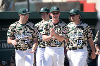 Slippery Rock pitchers Anthony Naso (24), Zac Anderson (38) and Jon Anderson (19) celebrate a run during a game against Kentucky Wesleyan College at Jack Russell Stadium on March 14, 2014 in Clearwater, Florida.  Slippery Rock defeated Kentucky Wesleyan 18-13.  (Mike Janes/Four Seam Images)