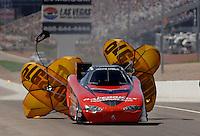 Apr 9, 2006; Las Vegas, NV, USA; NHRA Funny Car driver Gary Densham slows to a stop during the first round of eliminations at the Summitracing.com Nationals at Las Vegas Motor Speedway in Las Vegas, NV. Mandatory Credit: Mark J. Rebilas