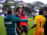 Referee Norbert Hauata red cards Jelewed Pierrot for a foul on Joel Stevens (2nd left) during the Oceania Football Championship semifinal (second leg) football match between Team Wellington and AS Magenta at David Farrington Park in Wellington, New Zealand on Sunday, 16 April 2017. Photo: Dave Lintott / lintottphoto.co.nz