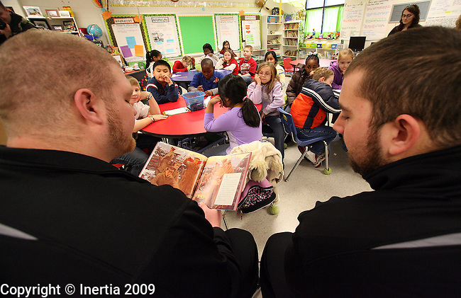 ROME, GA - DECEMBER 17:  Kyle Staudt, left, and TJ Wendt, right, of the University of Sioux Falls, read to third grade students at West Elementary School in Rome, GA, on Thursday morning, Dec. 17. The University of Sioux Falls Cougars are in Rome to play Lindenwood University Lions for the NAIA Football Championship on Saturday. (Photo by Dave Eggen/Inertia)