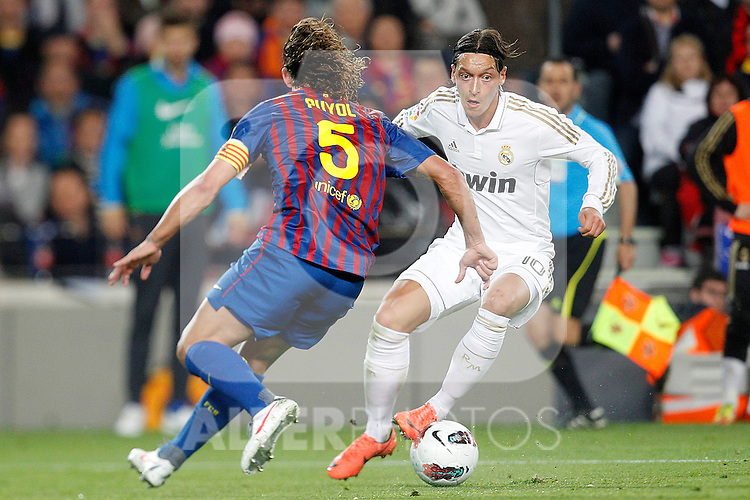 Barcelona's Carles Puyol and Real Madrid's Mesut Ozil during la liga match on april 21st 2012...Photo: Cesar Cebolla / ALFAQUI