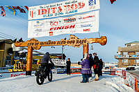 Iditabiker crosses  the finish line in Nome during the 2017 Iditarod on Thursday March 16, 2017.<br /> <br /> Photo by Jeff Schultz/SchultzPhoto.com  (C) 2017  ALL RIGHTS RESERVED