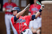 Tim Ferguson #4of the Ole Miss Rebels follows through on his swing against the St. John's Red Storm at the Charlottesville Regional of the 2010 College World Series at Davenport Field on June 6, 2010, in Charlottesville, Virginia.  The Red Storm defeated the Rebels 20-16.  Photo by Brian Westerholt / Four Seam Images