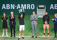 Rotterdam, The Netherlands, 18 Februari, 2018, ABNAMRO World Tennis Tournament, Ahoy, Singles final, Winner Roger Federer (SUI) with the trophy, next to tournament director Richard Krajicek the runner up Grigor Dimitrov, left CEO of the ABNAMRO Bank Kees van Dijkhuizen and right Director Ahoy Jolanda Janssen.<br /> <br /> Photo: www.tennisimages.com