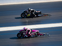 Nov 3, 2019; Las Vegas, NV, USA; NHRA pro stock motorcycle rider Angie Smith (near) against Karen Stoffer during the Dodge Nationals at The Strip at Las Vegas Motor Speedway. Mandatory Credit: Mark J. Rebilas-USA TODAY Sports