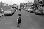 Child 1970s multiethnic multicultural England UK black British child poverty Hoxton Street Market east London UK 1978.