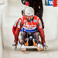 4 December 2015: Andris Sics and Juris Sics, sliding for Latvia, cross the finish line after their second run, finishing 3rd for the day with a combined time of 1:28.107 in the Doubles Competition of the Viessmann Luge World Cup at the Olympic Sports Track in Lake Placid, New York, USA. Mandatory Credit: Ed Wolfstein Photo *** RAW (NEF) Image File Available ***