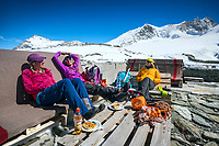 Laying in the sun after ski touring, at the Tracuit Hut, Switzerland