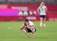KASHIMA, JAPAN - AUGUST 2: Carli Lloyd #10 of the USWNT sits on the field after a game between Canada and USWNT at Kashima Soccer Stadium on August 2, 2021 in Kashima, Japan.